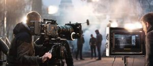 Filming an action scene on set