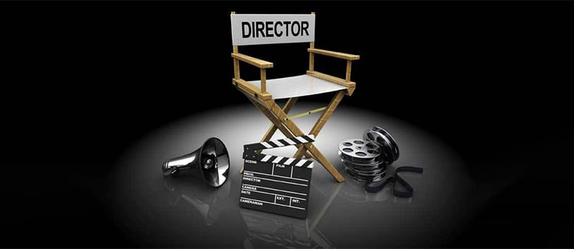Director chair with microphone and film near it.