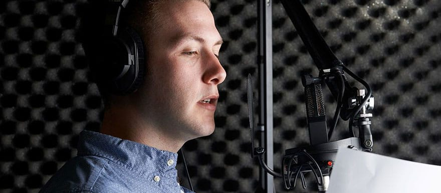 Male voice over professional speaking into a microphone.